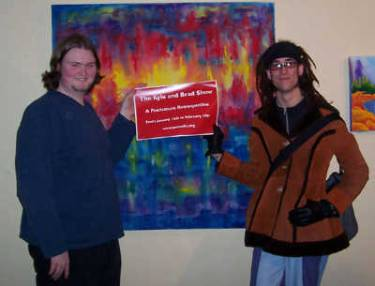 Kyle Clements and Brad Blucher proudly holding the sign for their very first art show.