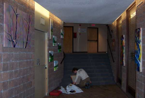 David Connors helping Kyle Clements unpack and install the art. 2007